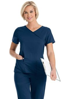 """Be an original. Be uniquely u. The style you love in a silky soft, more flexible fabric is just what you need! This women's crossover tunic scrub top has so much to offer and more. Features such as a shaped waistline, six pockets and and accessory loop, adds function to fashion. Tagless inside for even greater comfort. Designed for comfort with stylish durability you will wanting more and more! 54% Rayon/44%Polyester/2% Spandex. Available in sizes XS-5XL. Medium length: 25 7/8"""""""