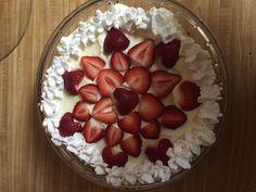 White chocolate vanilla bean cheesecake with strawberry garnish