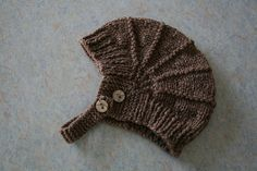 Aviatrix helmet, a very popular free pattern by Just Jussi -- sized from preemie to adult. For a beginning knitter who can knit and purl, this can take them to using short rows with confidence - and it is all straight knitting, with no seams. Determine the size you want to make and then... (Yarns & gauge can vary, but for beginner envision in heavy worsted weight with 7/'9 needles.)