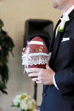 That's how you do a garter toss..men wont drop a football. love the idea.