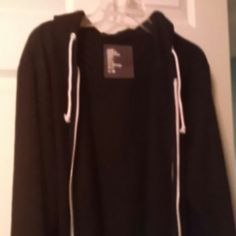 Men's sweater This sweater is all black except with white strings for the hood and a white lining along the zipper. It is in good condition without any rips or stains. H&M Sweaters