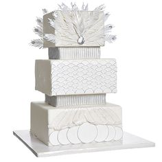Square Cake With Silver Accents and Sugar Feathers