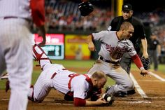 Crashing at home:     Washington Nationals' Danny Espinosa collides with Philadelphia Phillies catcher Cameron Rupp after being tagged out trying to score on a single by Trea Turner during the fourth inning, Aug. 30, in Philadelphia.  Washington won 3-2.