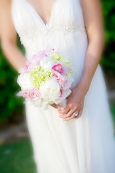 White peonies.  Pink roses.  Pink orchids.  Green hydrangea.