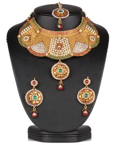 Bridal costume polki jewelry necklace set beautifully hand crafted on a gold background with Emerald, Ruby and clear polki stones-0626SMBR13 http://www.craftandjewel.com/servlet/the-1887/Bridal-costume-polki-jewelry/Detail