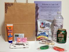 Welcome bag for a #CapeCod #wedding: -Hand-stamped, embossed craft paper bag -Sunscreen -Advil tablets -Pepto-Bismol tablets -Facial tissues -Welcome letter printed on lighthouse stationery -Cape Cod potato chips -Dried cranberries -Oyster crackers -Boston Fruit Slices -Personalized bottled water -Polar Pop ginger ale