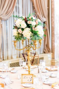 Flowers by Sisters Floral Design Studio www.sistersflowers.net   Image by Laura Ann Miller Photography Formal centerpieces of burgundy, ivory and blush- wine ranunculus, blush on a gold candelabra.  Coronado Ballroom Reception #sistersfloraldesignstudio