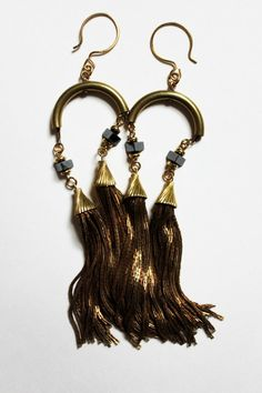 The dangliest of earrings by we never sleep. #MalloryMcInnis