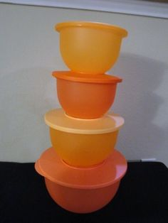 Tupperware Impression Bowls Set of 4 by Tupperware. $52.99. Colors Mango tangerine, Goldenberry Combo. Dishwasher Safe. Nesting bowls Set. Sizes are 2 5.5 cup bowls, 1 10.5 cups bowl and 1 18 cup bowl. Tupperware Wonderlier Bowl Set of 4. Perfect stack able (nesting) set. Meets all preparing mixing needs.  Nest for easy storage, seals act as stands.
