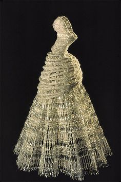 Chandelier dress by German visual artist Justen Ladda who is based in NYC. His work has been showcased at the Museum of Modern Art. This is his acrylic chandelier dress on a painted steel wire frame.