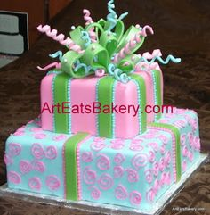 Two tier square pink, green and Tiffany blue fondant custom designed young lady's birthday cake with sugar bow