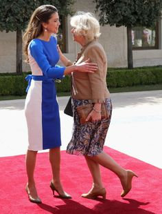 Camilla, Duchess of Cornwall curtsies as she greets Queen Rania of Jordan during a visit to the Royal Palace on 12 Mar 2013 in Amman