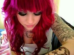 Pink hair and hello kitty tattoo