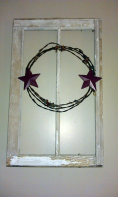 Barbed wire wreath... Not a fan of this design but I love the idea of putting a barbed wire wreath over an old window