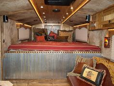 Horse trailer living quarters. Nice job to whomever decorated this! I could camp this way.