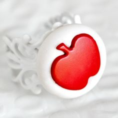 Red Apple Ring Snow White, Mirror Mirror Inspired Jewelry in White Glitter Polymer Clay. $18.00, via Etsy.