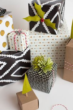 Using a graphic wrapping paper gives a fun and modern touch. Add a pom pom topper or mix patterns for a touch of whimsy.