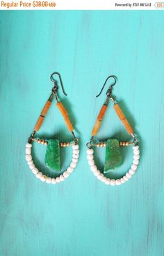 A personal favorite from my Etsy shop https://www.etsy.com/listing/239506135/on-sale-large-green-earrings-shell-agate