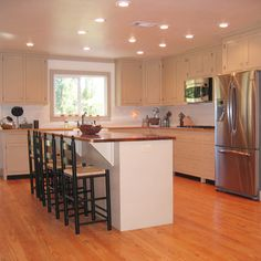 Love the look of this kitchen. To acheive this look in our kitchen, simply change the counter-top and island surfaces and install new floors.
