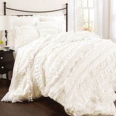 Bring a touch of romantic style to your master suite with this elegant comforter set, showcasing hand-sewn bows and a lovely ruffled design.   ...