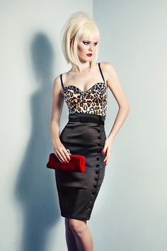 A perenial classic, the Irma La Douce Pencil Skirt is elegantly cut in double layered stretch matte deluxe satin to create the perfect silhouette.  Plush velvet buttons from waist to hip allow the garment to be worn sleek and slimline or undone to create a daring cocktail look.  High waisted with zip closure in the centre back for ease of wear. Belt not included. #NicheFashion