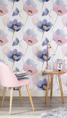 Think pink! This beautiful flower wallpaper brings together Pantone's colours of the year with charming watercolour poppies. Accessorise with pastel pinks and metallics for a delicately feminine look.