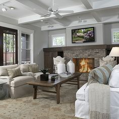 Ashley Goforth Design - living rooms - coffered ceiling, craftsman living room, brick fireplace, fireplace built ins, fireplace built in cabinets, face to face sofas,