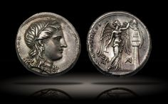 archaicwonder:  Greek Silver Tetradrachm minted under the Tyrant Agathokles from Syracuse, Sicily, c. 310/08-306/5 BC This lovely coins shows the wreathed head of Kore wearing a single pendant-style earring and necklace. The reverse shows the winged goddess of victory, Nike. She is standing right, holding a nail in her raised left hand and hammer in her right as she prepares to fix a conical helmet to a trophy of arms made of a cuirass, shield and greaves. There is also a monogram, a ...