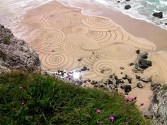 Gigantic, beautiful sand drawings take hours to make and minutes to start washing away