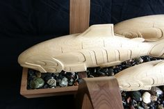 This coffee table has a 10mm oval shaped glass top and two u-shaped table legs surrounding a sculpture of three salmon (twomale, one female). The salmon are on plate with pebbles simulating a scene of salmon swimming in a river or creak. All together, these parts create a stunning, modern, yet indigenous coffee table. Esteemed …