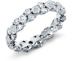 Clustered diamond wedding band! (Looooooove! Paired with a smaller engagement ring.)
