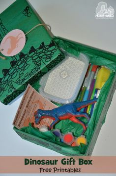 What gift do you buy a child who loves dinosaurs? Well, there's plenty of wonderful dinosaur gift ideas out there but I preferred to make my own box of goodies this year. Includes free printable activity card and gift tag.