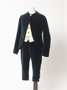 1880 Boy's Suit Culture: English Medium: velveteen, satin Dark blue velveteen jacket, breeches and waistcoat, and an evening waistcoat of cream coloured satin.