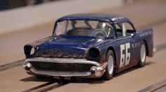 """Gene Wenzel built this 1/25 scale 57' Chevy Sportsman with a custom fabricated Carrera 1/32 extended chassis, 18,000 RPM Carrera motor, stock gearing, C.B. Design 1:24 Classic Steel Wheels (painted) and Paul Gage Tires.  The chassis is mounted to the body using wire nuts.  The body """"rust"""" is a really cool feature!"""