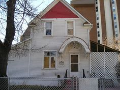 love this house everytime I see it. Near my school.  H027_1407 12 ST SW P1 by Calgary_Heritage_Initiative, via Flickr