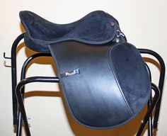 003. Brand New Rhinegold Synthetic saddle 15ins Wide/Extra Wide, £110.00