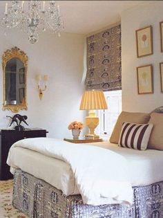 Charming bedroom - tailored bedskirt and Roman shade + glitzy chandelier and mirror
