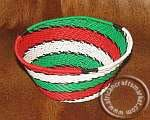 An African wire bowl that is crafted by hand out of colorful telephone wire by Zulu artist. The telephone wire bowl is 25 cm in diameter and set in the colors of Red, blue white and brown.
