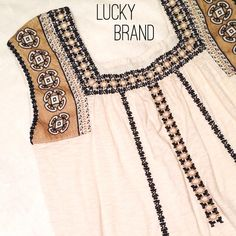Cream with black & gold Lucky Brand top Very cute and unique lucky brand tank/top. Cream with embroidered black and gold designs. Size medium. Lucky Brand Tops Tunics