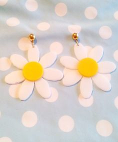 These Sweet Daisy earrings are perfect for Spring (or any time of the year!) They were designed digitally, and then laser cut with white and yellow acrylic. The Daisy is white, and the center is yellow. The earrings are about 2.5 inches around.