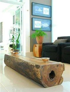 Fallen tree trunk upcycled into a coffee table. Love!