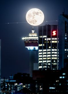 Supermoon on the Calgary tower with an airplane flying in front, I think I got it!