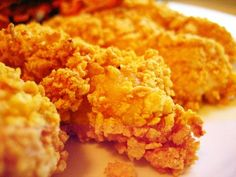Popeye Fried Chicken Recipe.  Awesome chicken but the recipe is brutally (but hysterically) translated.  Mix the dry ingredients in one pan, crushed corn flakes in one and the eggs and water in another.  Dip chicken in dry ingredients, then egg mixture, then corn flakes, then again in the dry ingredients and brown on both sides then put into a baking dish and bake in a 350 oven until done.