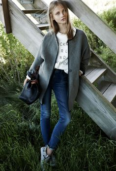 Madewell wrap coat worn with high riser Alley straight jeans.
