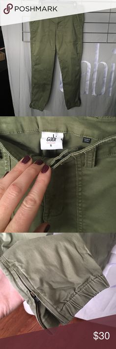 Cabi traveler pants Cabi traveler pants in size 8. Done in a wonderful army green color. Crop length that can be work just at the ankle and has elastic to keep them close and flattering on the leg. Or unzip and roll to make it a true crop!  Most people sized down in these (so a 10 would wear an 8) as they fall out a bit after wearing! Amazingly soft pant!! Style #5076 spring 2016 CAbi Pants