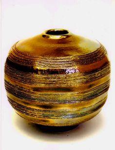 M. Wein, golden copper raku.