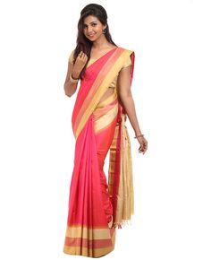 Silk Fabric. Twin Color. Body is dual tone (orange and pink) silk plain body. Multicolor border. Pallu is traditionally designed golden color zari pallu with multicolor border. Blouse is chikoo color plain silk blouse with multicolor border.