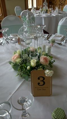 Birdcage and flower wreath, by Lily King Weddings