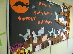 I think that Halloween is my favorite holiday to decorate my classroom for. This week we finished our Halloween cats and I put them on the. October Bulletin Boards, Halloween Bulletin Boards, Preschool Bulletin Boards, Classroom Bulletin Boards, Classroom Door, School Classroom, Kindergarten, Old Book Pages, Library Displays