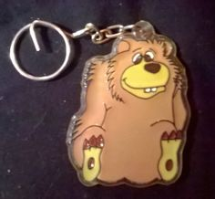 Hard Plastic Brown Bear Rare Item Collectible Measures about 7.5 cm X 5 cm  This is a used item. There could be normal wear on the item so check